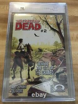 Walking dead 1 PGX 9.8 Signature Series Black Label signed by Kirkman (not CGC)